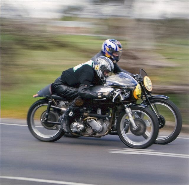Bob the Milky on the Norton International pre-war 500 nonchalantly passing John Whalin – DBS350 Special – on the inside